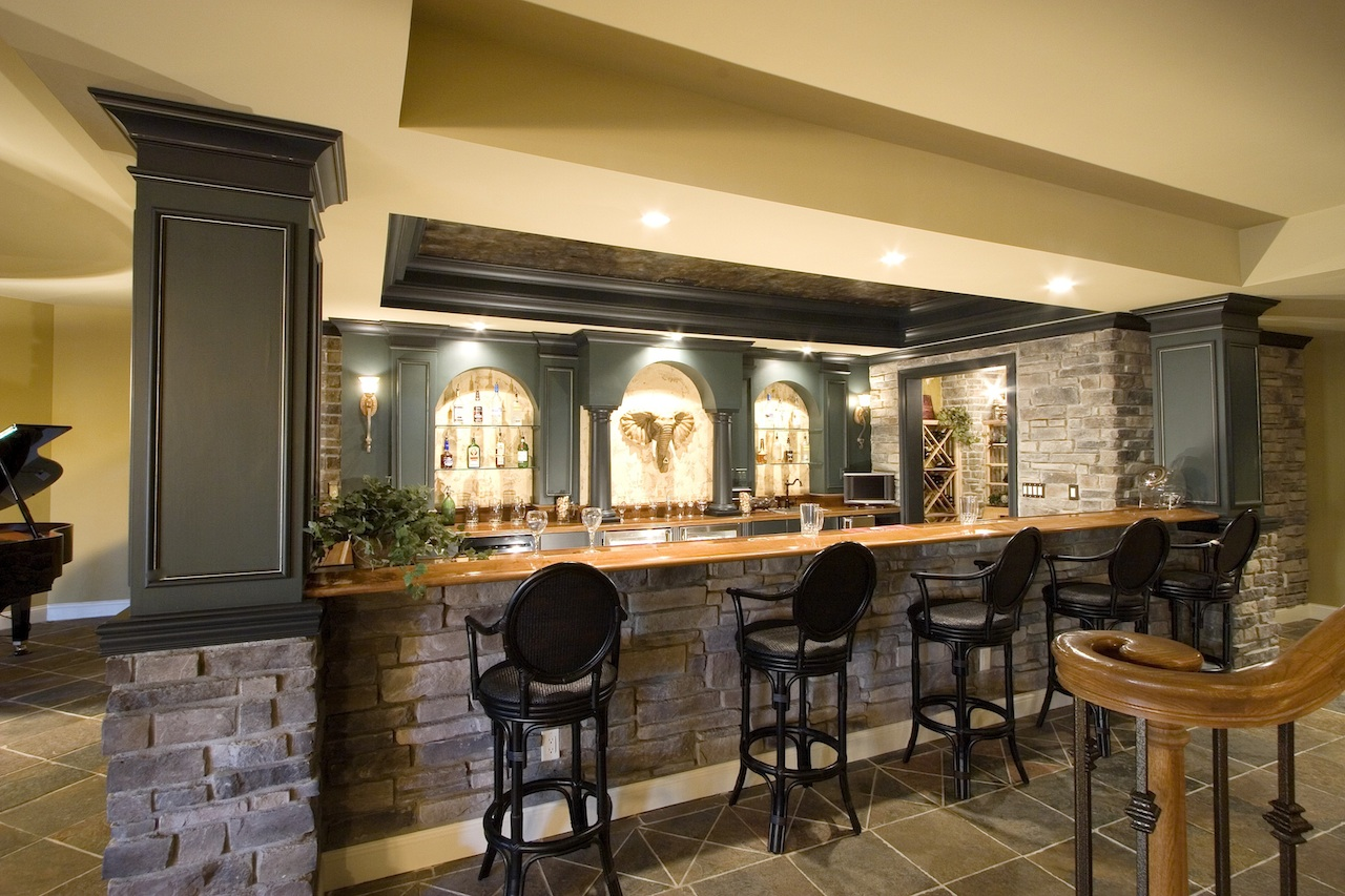 The stone is the perfect finish to this basement bar complete